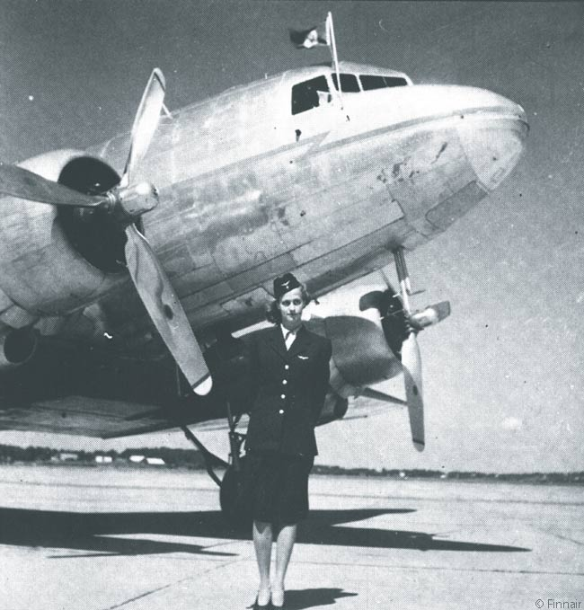 Air stewardess Kaarina Wendelin of Finnair's predecessor carrier Aero Oy is photographed at Malmi in 1937 with a Douglas DC-3 belonging to the airline. Later that year the carrier gave individual names to each of its aircraft