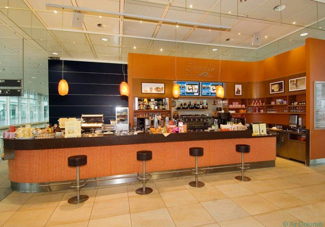 This photograph shows the café/wine bar in Air Dolomiti's 'Spazio Italia' at Munich Airport. The café/wine bar only sells Italian-recipe foods and beverages and Italian wines