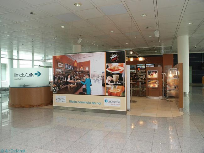 This photograph shows the 120-square-meter, multi-functional area in Air Dolomit's 'Spazio Italia' at Munich Airport. The airline uses this space to promote Italian companies' products and services and the space pays for itself from the profits made by Air Dolomiti's adjoining café/wine bar