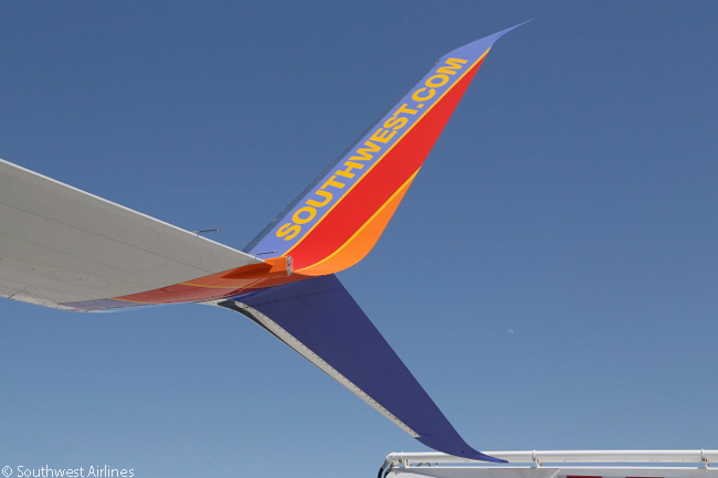 This close-up photograph of an Aviation Partners Split Scimitar Winglet on a Southwest Airlines Boeing 737-800 shows the winglet's elegant curved lines and almost symmetrical shape