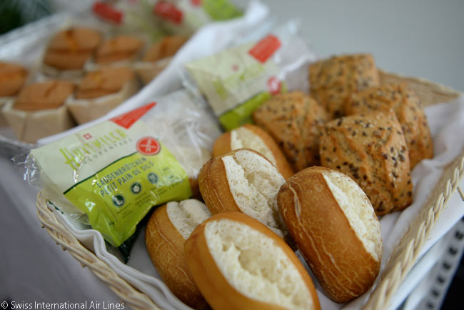 One of Swiss International Air Lines' many measures to reduce its passengers' exposure to allergens is to offer alternative, lactose- and gluten-free food and drinks. Among the various gluten-free foods it offers allergy sufferers are dinner rolls