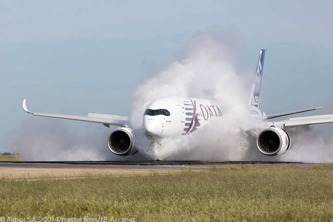 Flight-test Airbus A350-900 MSN4 throws up a huge plume of water spray as it travels quickly through a trough of standing water at Istres-Le Tubé Air Base in the South of France in May 2014, during certification testing to demonstrate the A350 XWB's ability to operate on wet runways