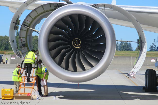 Maintenance technicians work on the No. 2 Rolls-Royce Trent 1000 engine of Air New Zealand's first Boeing 787-9 as it is docked at Boeing's Widebody Delivery Center at Everett the day before its delivery flight