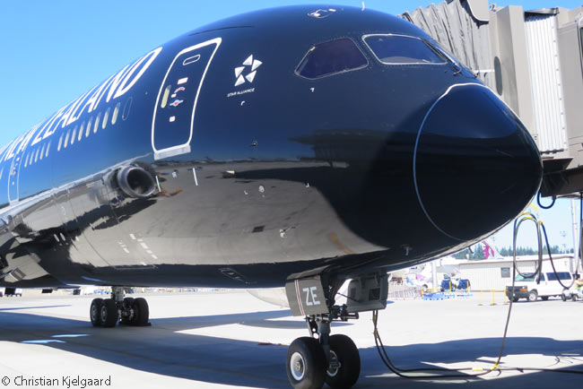 The glossy black 'All Black' livery adorining Air New Zealand's first Boeing 787-9 is so reflective that on a sunny, clear day it takes on a blue tinge as it reflects the color of the sky