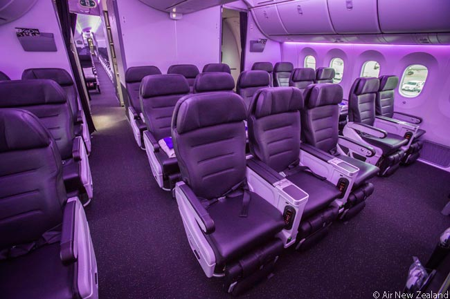 Seen under LED cabin lighting set here to produce a relaxing violet color, the Premium Economy cabin in each Air New Zealand Boeing 787-9 contains 21 seats. The seat was designed specifically for the airline's 787-9s