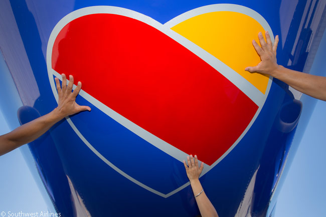 Southwest Airlines' new fleet-wide aircraft livery includes the carrier's new three-colored 'Heart' logo next to each of the aircraft's doors, on its engines and also on the aircraft's belly