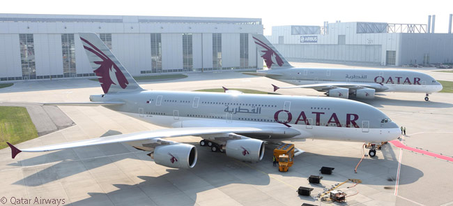 Qatar Airways' second new Airbus A380, also due for delivery in the second half of 2014, is visible behind the first. The airline took delivery of its first A380 on September 17, 2014