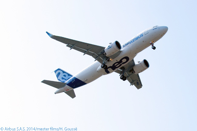 The large (81-inch) fan diameter of the Pratt & Whitney PurePower PW1100G-JM engines powering the first flight-test Airbus A320neo is very apparent in this photograph of the aircraft passing overhead during its first flight