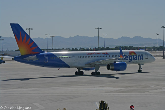 Allegiant Air Boeing 757-200 N906NV taxies away towards its take-off runway from its docking gate on Concourse A of Las Vegas McCarran International Airport's Terminal 1