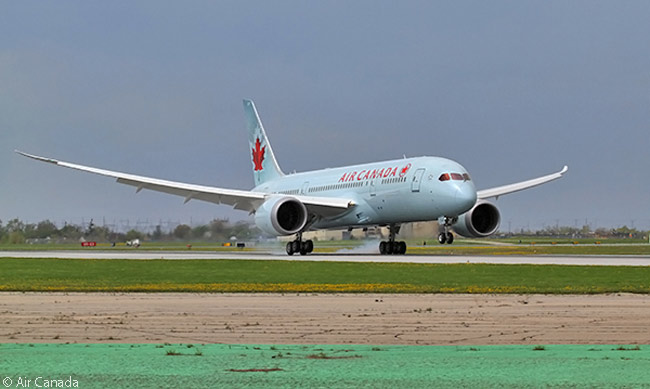 Air Canada's first Boeing 787 Dreamliner, operating flight AC7008 as its delivery flight from Boeing's Everett widebody-assembly and delivery facility, lands at Toronto's Pearson Airport on May 18, 2014