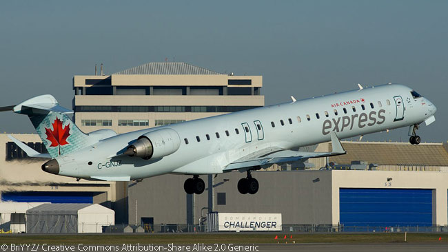 Jazz Aviation LP Bombardier CRJ-705 C-GNJZ departs Montréal-Trudeau International Airport operating an Air Canada Express flight