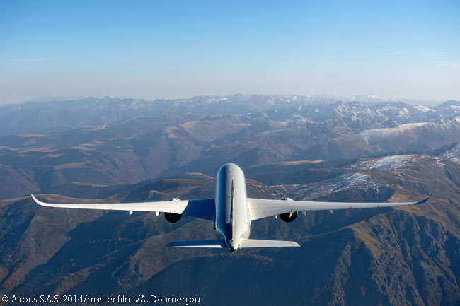 During an air-to-air photo shoot, Qatar Airways' first Airbus A350-900 is captured flying over a high mountain range: probably the Pyrenees, which are relatively close to Airbus' widebody final-assembly line at Toulouse
