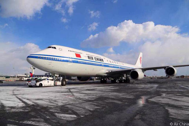 New York JFK became Air China's first Boeing 747-8I destination when flight CA981 landed at JFK early in the afternoon of January 7, 2015. In this photo, the aircraft operating the inaugural Beijing-New York 747-8I flight is being towed to its arrival gate at JFK's ramp-congested Terminal 1 after landing and taxiing