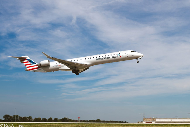 A Bombardier CRJ900 NextGen regional jet operated by PSA Airlines for the American Eagle network takes off from Dayton International Airport