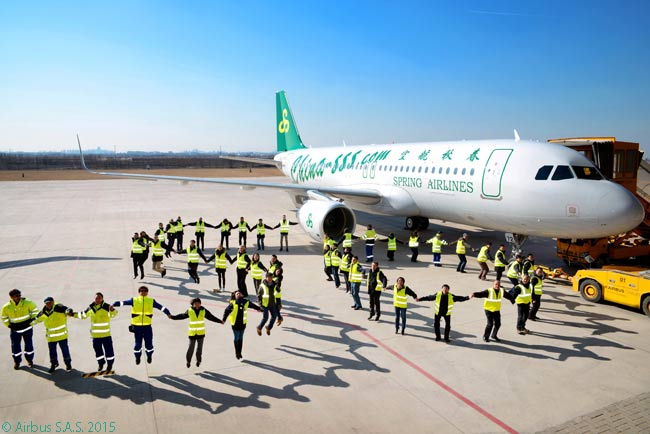 In a human chain, employees of Chinese low-cost carrier Spring Airlines make the number '50' in front of the airline's 50th A320, which the all-A320 operator received on February 11, 2015