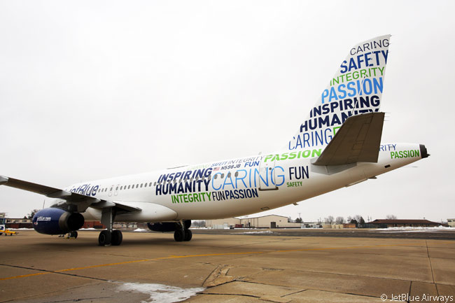 "JetBlue Airways' 'Bluemanity' livery, which adorns an Airbus A320, features a word cloud of the values the airline says it and its employees share, along with its professed mission of ""Inspiring Humanity"""