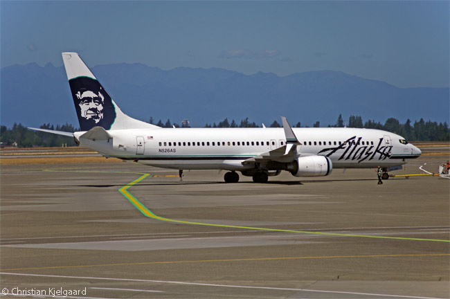 Alaska Airlines Boeing 737-800 N526AS is pushed back from one of the 'N' gates in the North Satellite terminal at Seattle-Tacoma International Airport, the airline's main base. Note that the aircraft's wingtips have had 'Split Scimitar' winglets installed on them