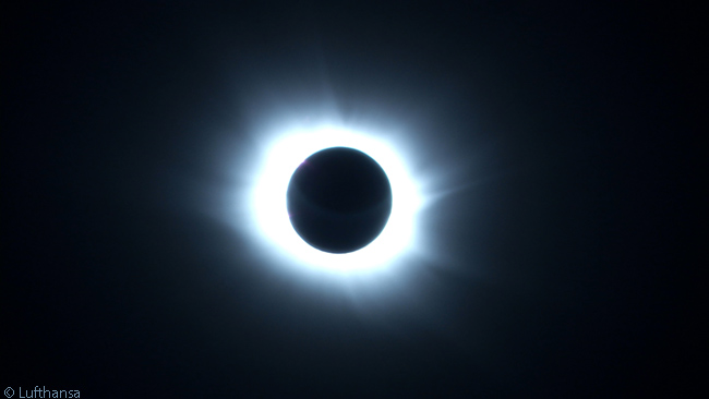 Early on March 20, by means of a pre-agreed slight course change, people on board Lufthansa flight 435 from Chicago to Munich were able to view a complete eclipse of the sun by the moon