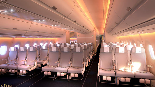 This is what the economy-class cabin of a Finnair Airbus A350-900 looks like, with the variable-color LED cabin lighting set to produce a sunset feel