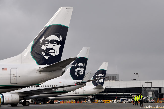 Alaska Airlines' distinctive tail logo is an extremely common sight at Seattle-Tacoma International Airport, its home base and largest hub