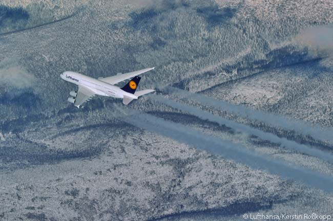 This excellent minimalist shot, clearly taken from the cockpit of an aircraft traveling at an even higher cruise altitude, shows a Lufthansa Airbus A380 in cruise flight over a snowy landscape