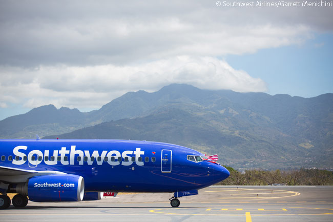 Flying a celebratory flag from its cockpit, the Boeing 737-700 operating Southwest Airlines' inaugural flight to Costa Rica on March 7, 2015 is seen here taxiing after landing at Juan Santamaría International Airport, which serves Costa Rica's capital San José