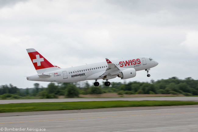 The first Bombardier CS100 painted in the lilvery of launch customer Swiss International Air Lines takes off from its base at Montreal Mirabel Airport on a test flight before the Paris Air Show 2015, for which the aircraft flew over to Paris to star in the show's static display of aircraft