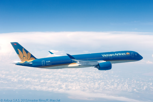 Vietnam Airlines' colorful livery is shown off to good advantage in this air-to-air shot of its first Airbus A350-900 operating a pre-delivery test flight