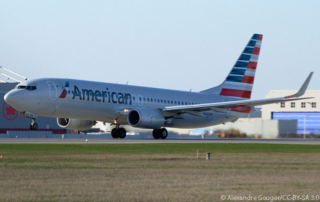 American Airlines Boeing 737-800 N180AN departs Montreal-Trudeau International Airport in April 2013