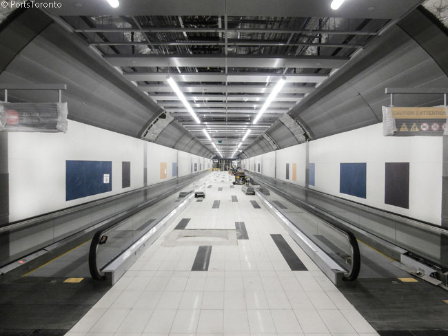 This is the 853-foot main passageway of the passenger tunnel linking Lake Shore Boulevard on Toronto's mainland with Billy Bishop Toronto City Airport, which is located on Toronto Island in Lake Ontario. The tunnel's official opening date for public use was July 30, 2015