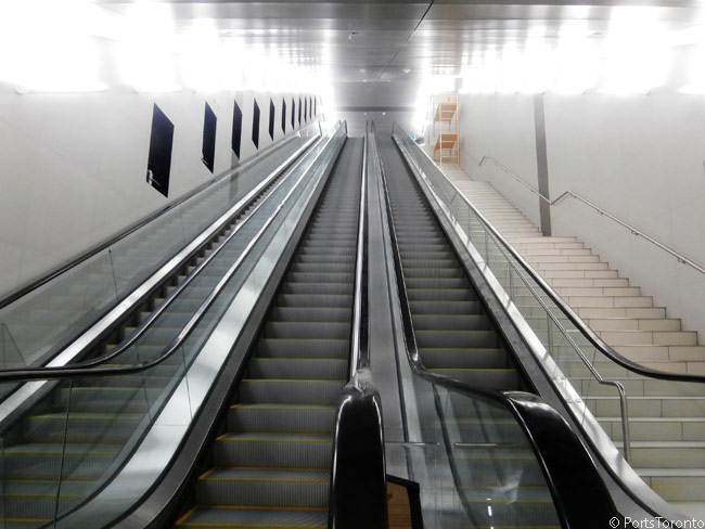 These are the long escalators at the southern end of the new passenger tunnel under Lake Ontario's Western Channel. The tunnel links Billy Bishop Toronto City Airport on Toronto Island with the mainland of Toronto, and routes under the narrow Western Channel of Lake Ontario