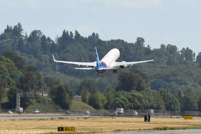 A new Boeing 737-900ER, one of two received by Indonesian carrier Sriwijaya Air on August 20, 2015, takes off from Boeing Field in Seattle