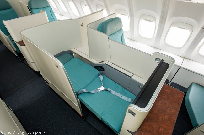 This is what Business Class Prestige Suites in Korean Air's Boeing 747-8 Intercontinental jets look like, with the aisle seat reclined into a flat bed. The suites feature staggered seating and have privacy panels