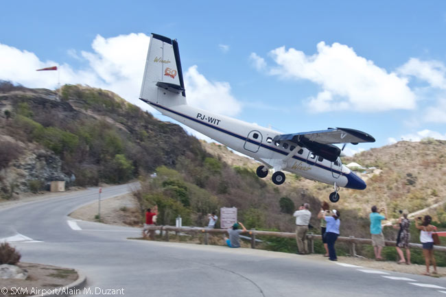 The approach to Gustaf III Airport on the Caribbean island of Saint Barthélemy is commonly called 'The Saint Barth Dive' by pilots, with good reason. This photograph shows a Winair Twin Otter executing the maneuver