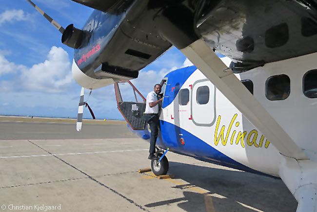 A Winair Twin Otter captain boards an aircraft before flying it to Saint Barth. Although the flight is scheduled with a block time of only 12 minutes, the approach to Saint Barth's Gustaf III airport is one of the most extreme in the world