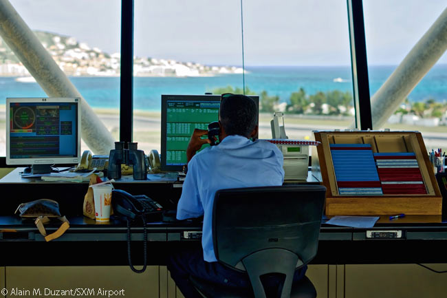 Air traffic controllers in the SXM Airport tower on Sint Maarten often coordinate with their opposite numbers in towers at small airports on various islands in the Eastern Caribbean, and also their FAA counterparts at the San Juan Combined En Route Approach Control Facility in Puerto Rico