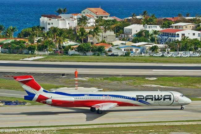 An MD-83 of PAWA Dominicana taxis out for take-off at SXM Airport on Sint Maarten. 'PAWA' stands for 'Pan American World Airways', though the carrier is based at Santo Domingo in the Dominican Republic