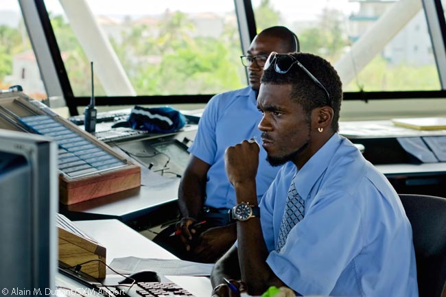 Juliana Air Traffic Services controllers work in SXM Airport's control tower. In addition to handling all the traffic for Princess Juliana International Airport, a busy hub for commercial and business aviation, they provide approach and tower services to five other airports on five Eastern Caribbean islands and territories