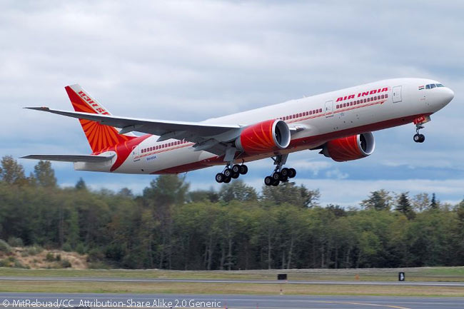 This photo shows Air India Boeing 777-200LR VT-ALD landing at Boeing Field in Seattle after a pre-delivery test flight, with the aircraft wearing a U.S. test registration