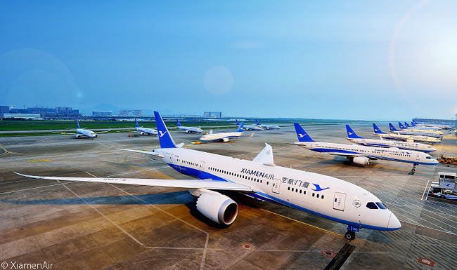XiamenAir is using Boeing 787-8s and 787-9s to operate intercontinental services from its hubs at Xiamen and Fuzhou in China's Fujian province to intercontinental destinations in Oceania, Europe and North America. Here, a XiamenAir 787-8 is in the foreground of a long line of the airline's aircraft parked at gates at its main hub at Xiamen Gaoqi International Airport in China's Fujian province