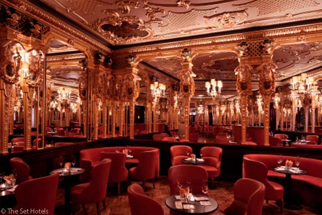 In London's Hotel Café Royal, the former café's Grill Room has been restored to its earlier gilded, mirrored Louis XVI-style opulence and renamed the Oscar Wilde Bar. It is open for afternoon tea and occasional evening cabaret performances