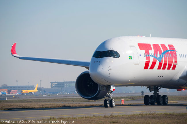 TAM Airlines' first Airbus A350-900 taxis out to Toulouse Blagnac International Airport on December 17, 2015 to depart for its delivery flight to Brazil