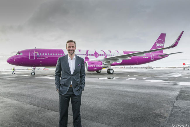 Wow Air founder and CEO Skúli Mogensen is seen here with one of the Icelandic ultra-low-cost carrier's Airbus A321s, which it uses to serve North America from its base at Keflavik International Airport