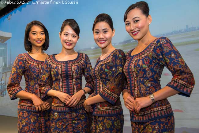 Four 'Singapore Girl' SIA flight attendants posed for the camera at the Airbus Delivery Center at Toulouse Blagnac Airport on March 2, 2016, as Singapore Airlines took delivery of the first of 67 Airbus A350-900s it ordered
